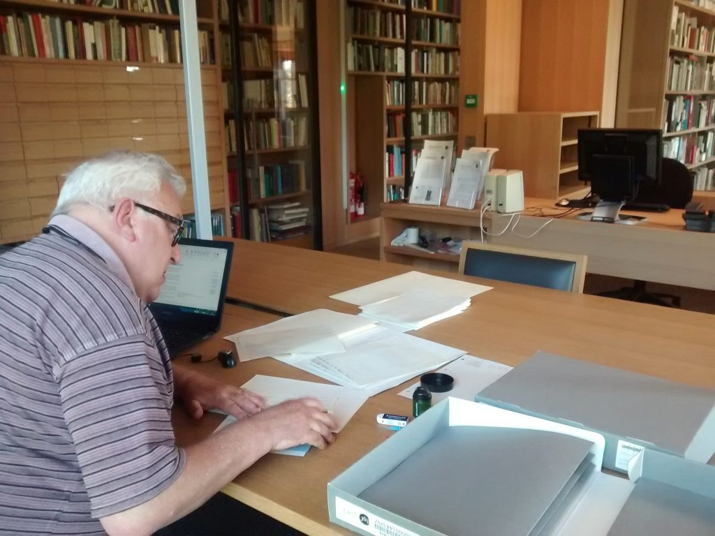 One of our project volunteers repacking correspondence into acid-free papers and folders